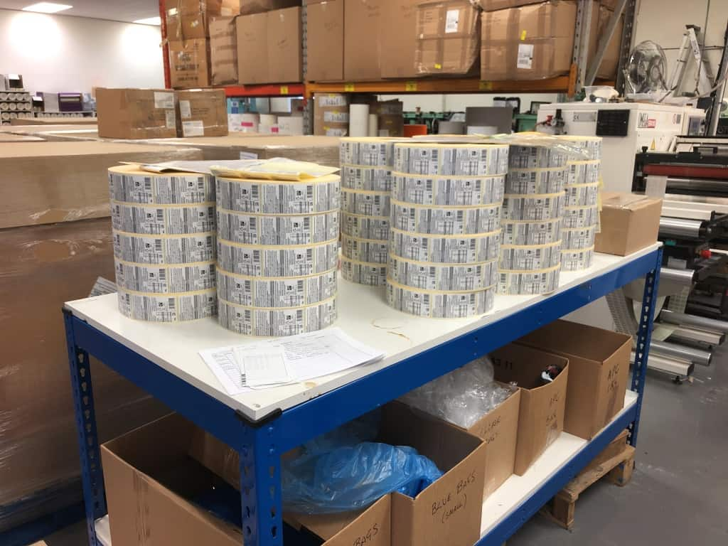 Reels of self-adhesive labels printed ready to be dispatched